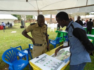 Police Chief of Nansana studies a security solution embedded in the community urban plan